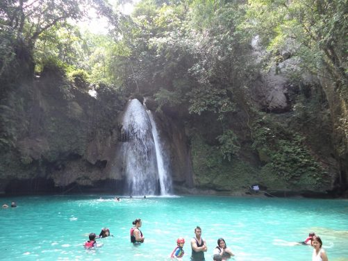View of Kawasan Falls. This 25-metre high waterfall, located near the small town of Badian to the south of Cebu, is one of the island's main tourist attractions. It is on the Matutinao River, which flows through a secluded canyon above the falls, where canyoning activities frequently occur.