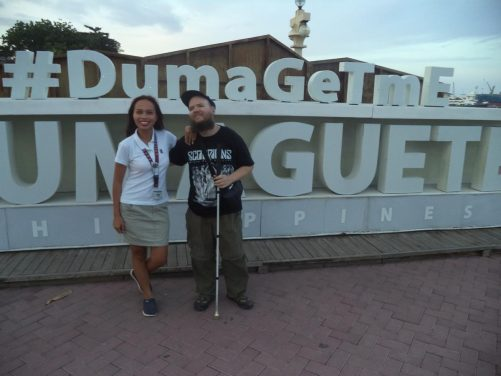 Another closer view of Tony in front of the 'Dumaguete' sign.