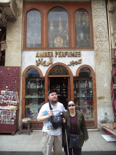 Tony, Tatiana outside a perfume shop after purchasing a bottle of perfume! They are in Khan al-Khalili bazaar, Cairo's largest market.