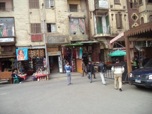 A rather dilapidated looking row of shops at Khan al-Khalili bazaar, mostly selling clothes and craft items.
