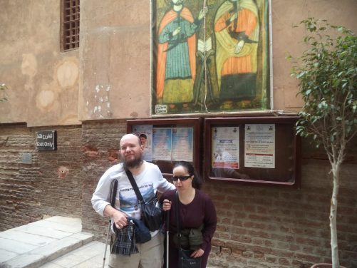 Tony and Tatiana outside Saints Sergius and Bacchus Church in Coptic Cairo. This is one of the oldest Coptic churches in Egypt dating back to the 4th century. It is said to have been built on the spot where the Holy Family, Joseph, Mary and the infant Jesus Christ rested at the end of their journey into Egypt. Tony and Tatiana were unable to enter the church due to a mass.