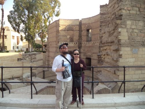 Tony and Tatiana on Mar Girgis Street close to the Hanging Church. Behind are the ruins of a Roman prison.