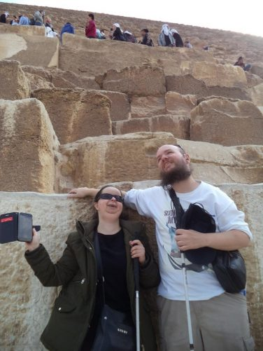 Tony, Tatiana touching the huge lower stones of the Great Pyramid.