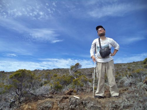 Tony in the rocky landscape near Piton de la Fournaise volcano.