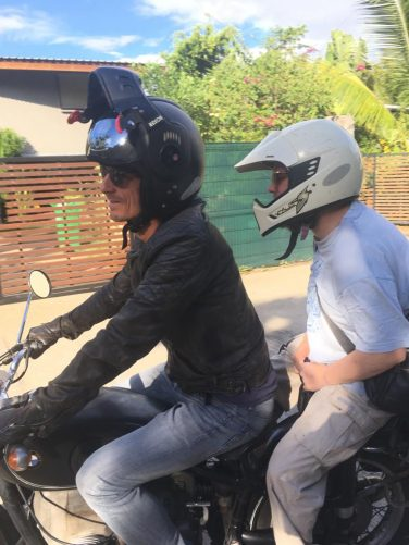 Jens and Tony riding on the motorbike. They are heading to St-Denis, the capital town of Réunion. About a 30-minute drive from St-Paul.