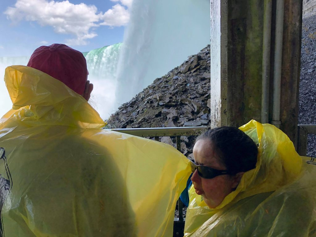 Tony and Tatiana in a viewing area with the massive curtain of water falling in front.