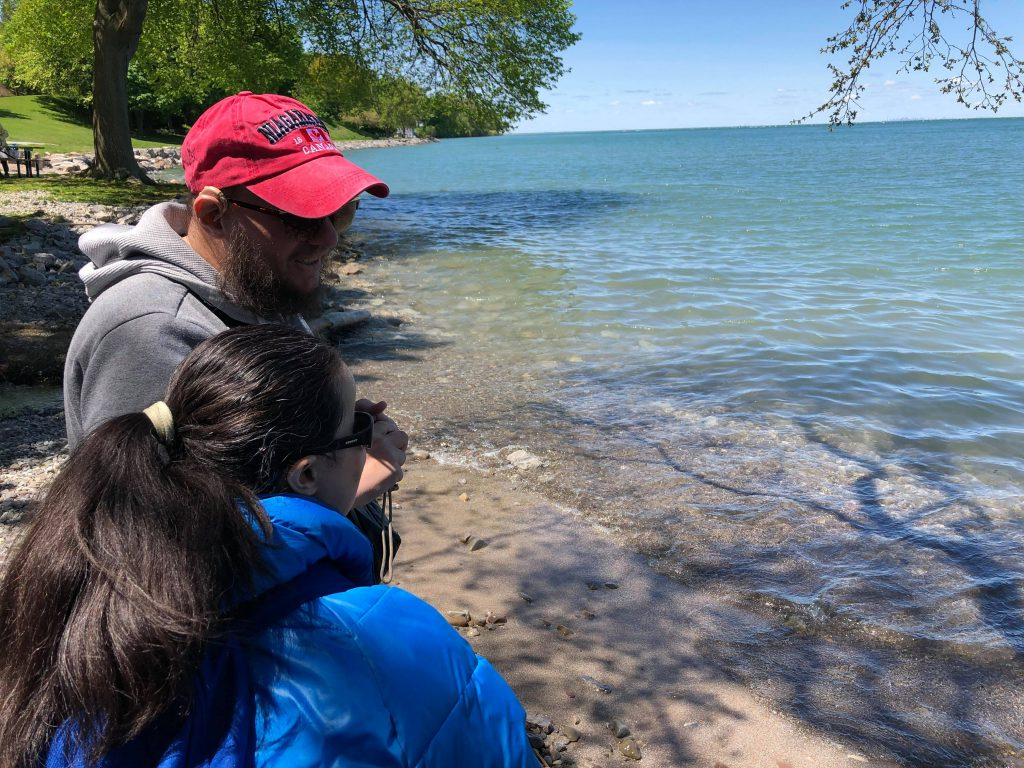 Tony and Tatiana on the shore of Lake Ontario. One of the five Great Lakes on the border of the US and Canada. It is the smallest of the Great Lakes, although still very large at 7,320 square miles in area.
