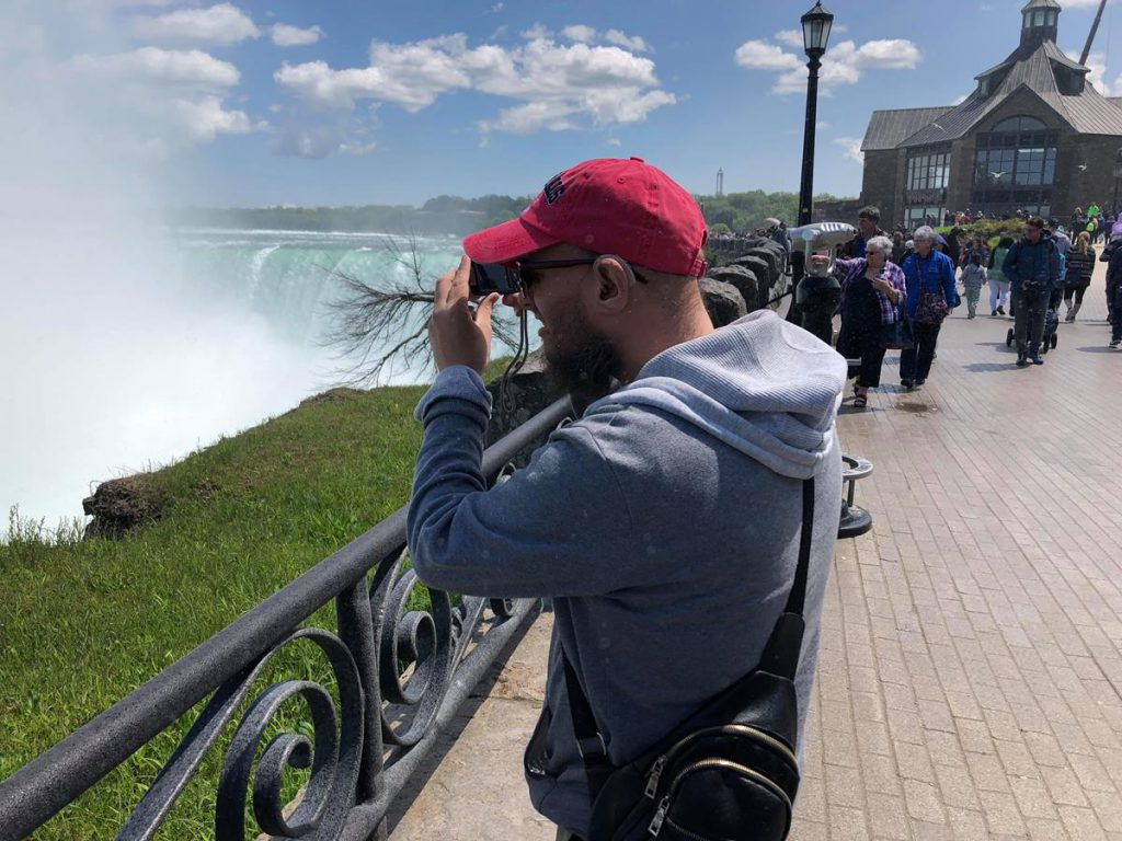 Tony taking a photo of the falls. Spray rising up from the crashing water.