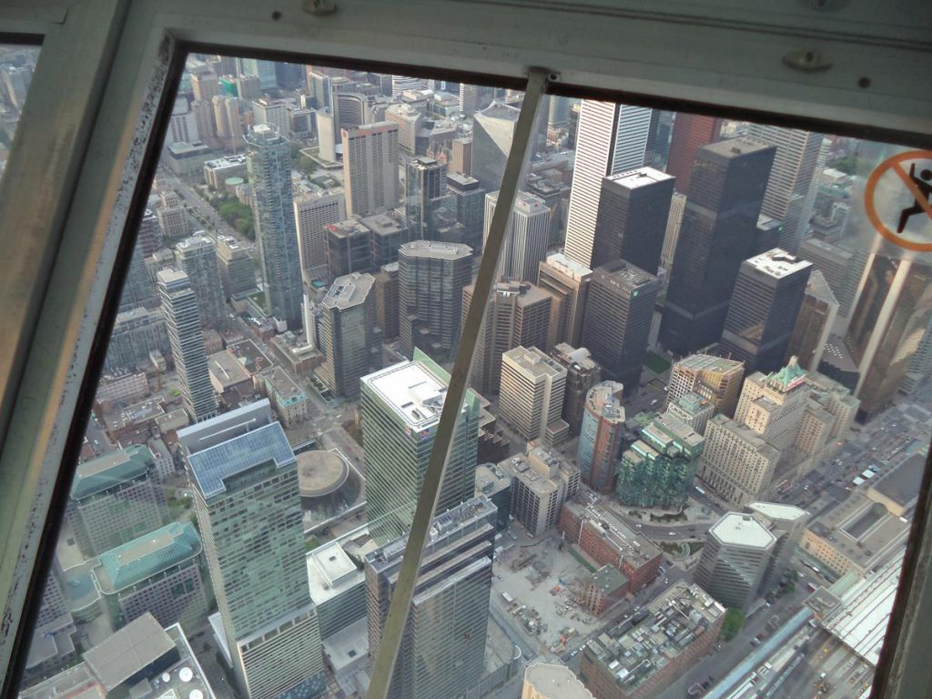 High-rise buildings of the city's downtown below. Several of these buildings are more than 250 metres in height, but are still some way below the CN Tower's SkyPod observation platform at 447 metres.