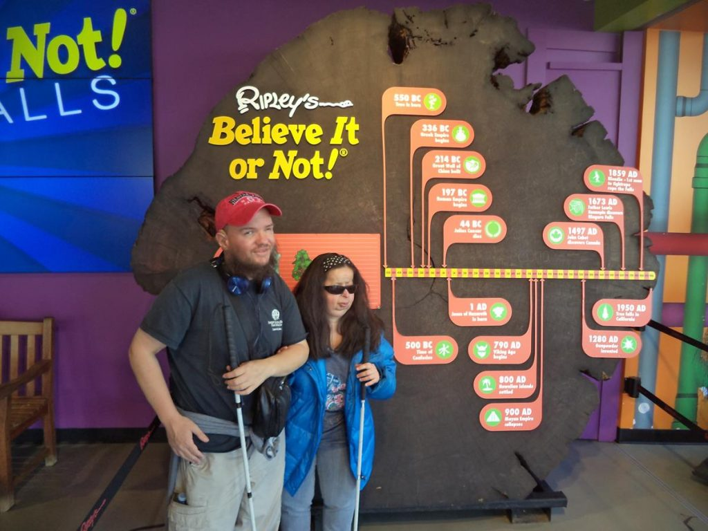 Tony and Tatiana in front of a cross section from a huge maple tree. It is claimed that the tree was 2500 years old when it fell in California in 1950. At Ripley's Believe It or Not! Museum.
