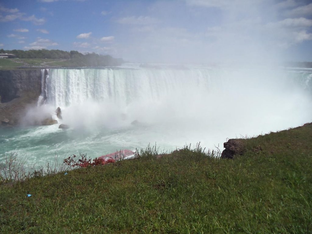 Dramatic view of Horseshoe Falls. The crashing water creating mist which is rising high into the air.