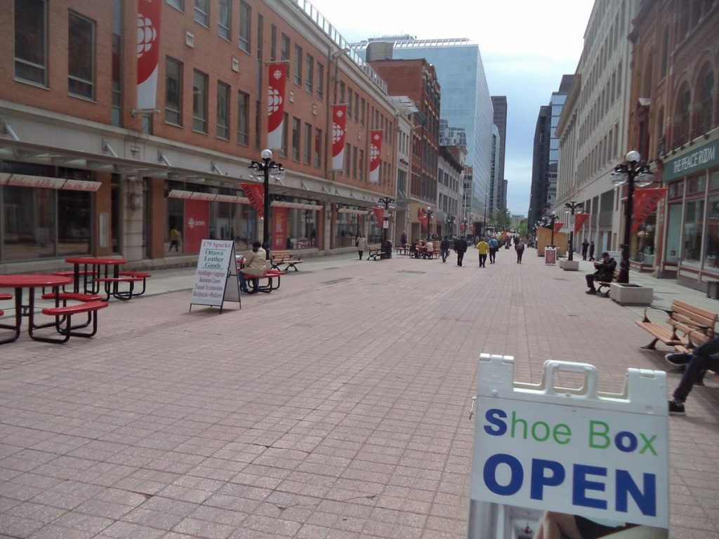 View along Sparks Street, a pedestrian street in central Ottawa lined with shops, cafés and restaurants, as well as offices and government buildings. Tim Horton's Cafe, a famous Canadian coffee shop, is located along this street.