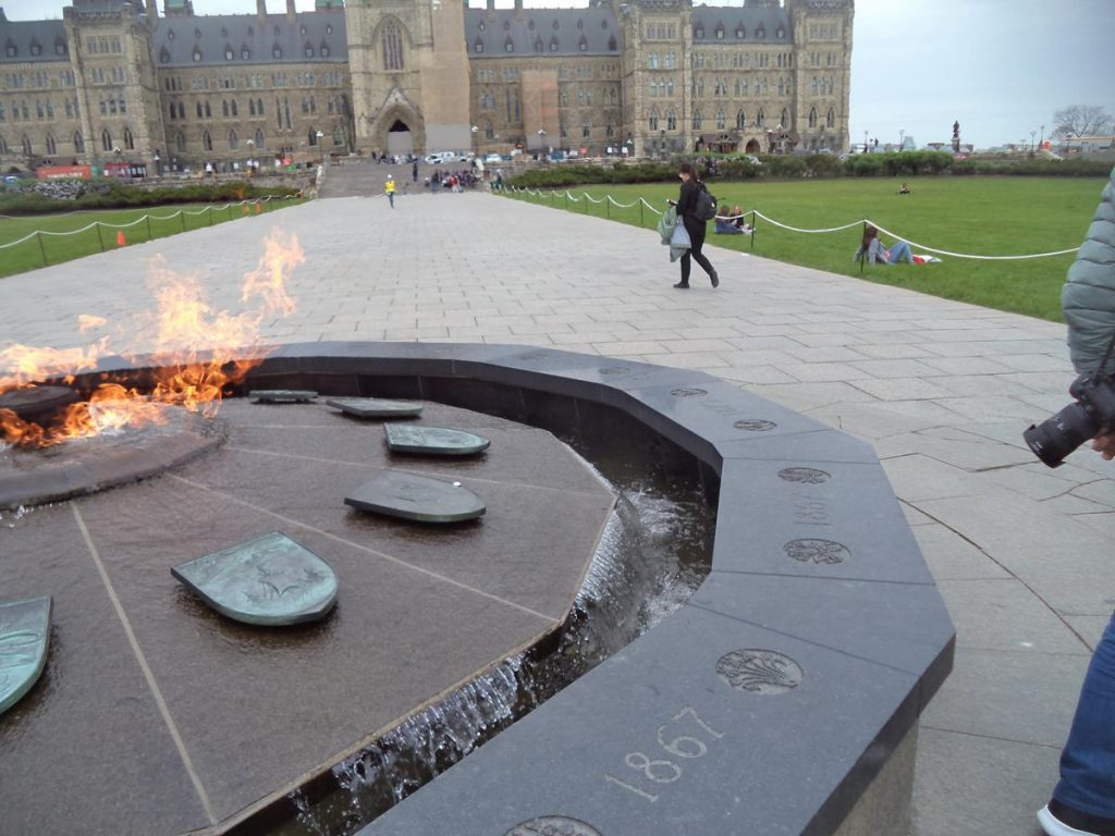 Closer view of some of the Centennial Flame's shields representing Canada's 13 provinces and territories with the flame in the middle. There are ten Provinces: Alberta, British Columbia, Manitoba, New Brunswick, Newfoundland and Labrador, Nova Scotia, Ontario, Prince Edward Island, Quebec and Saskatchewan. The three territories: Northwest Territories, Nunavut and Yukon.