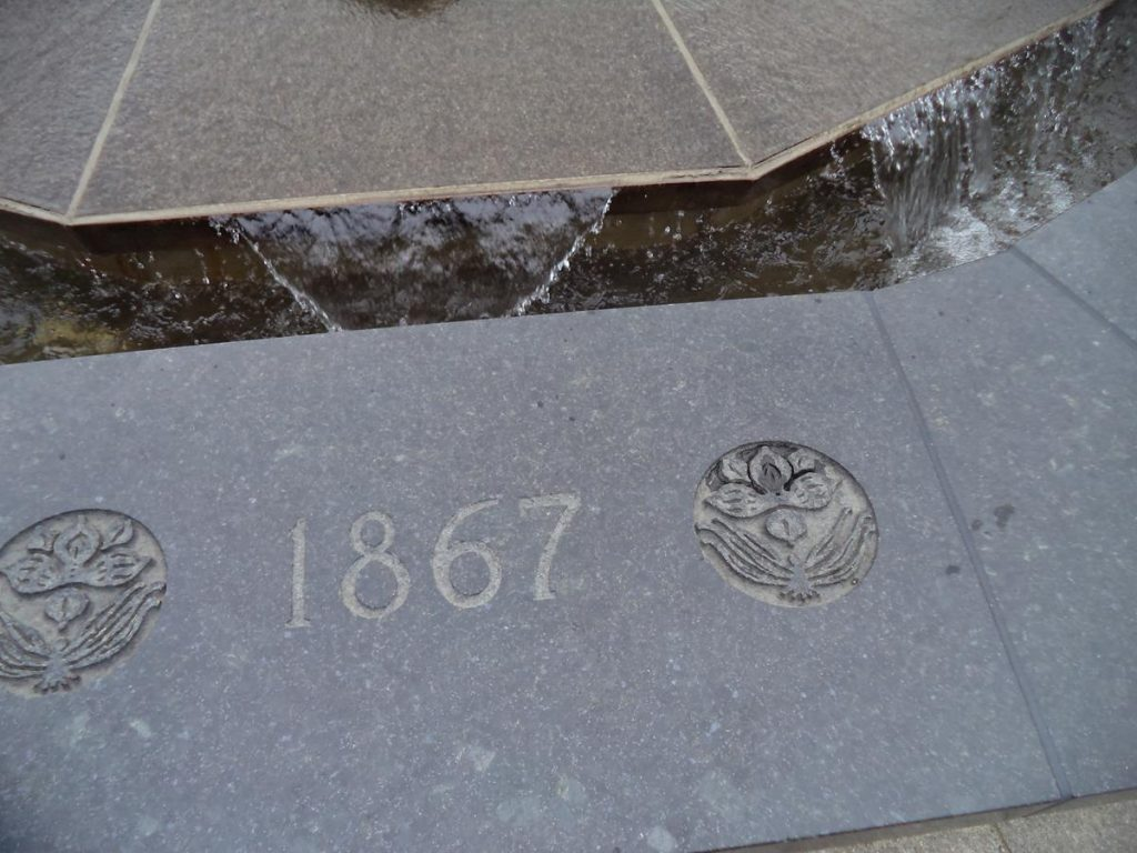 The date '1876' written on the outside of the Centennial Flame: the Canadian Confederation was formed on 1st July 1867, uniting the British colonies of the Province of Canada, Nova Scotia, and New Brunswick into one Dominion of Canada.