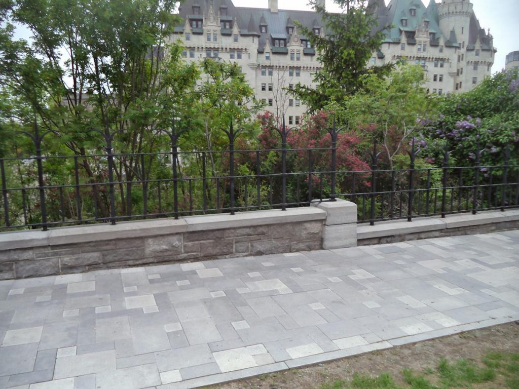 View towards Château Laurier, a large 426 room hotel that opened in 1912. In style it is Gothic Revival, similar to the Parliament Buildings which are located immediately to the west. Its style is described as Châteauesque, because it is built to look like a French château, with features resembling a castle such as towers and turrets.