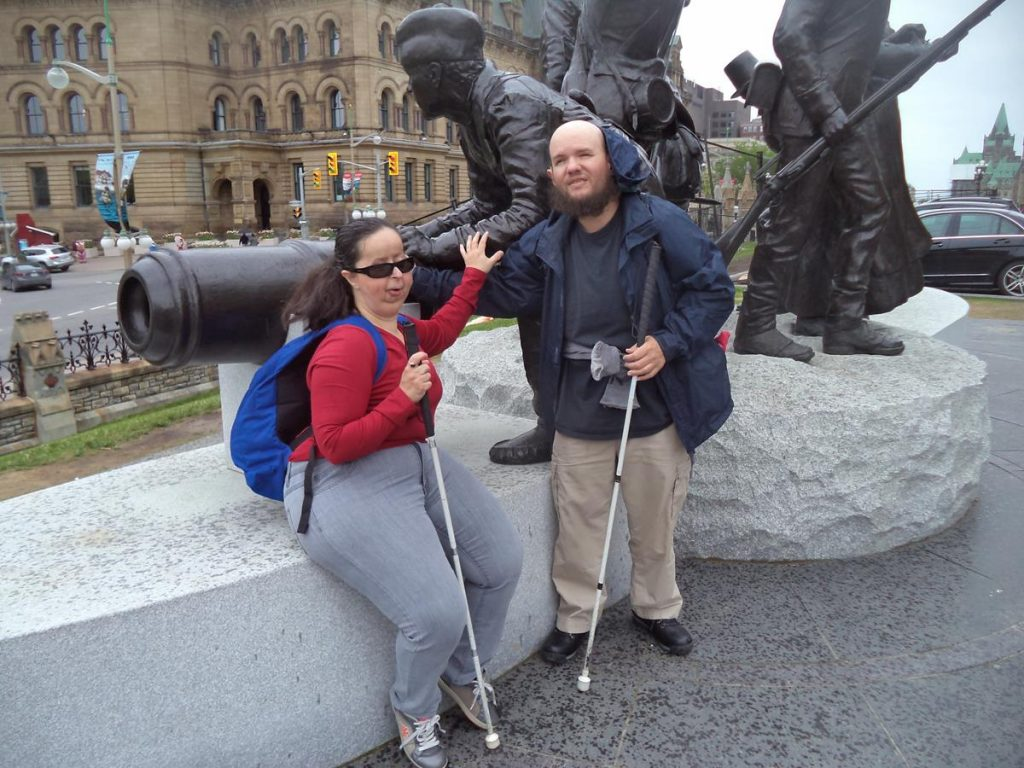 Tony and Tatiana touching the War of 1812 Monument located at Parliament Hill. The monument is made of bronze on a stone base. Seven human figures are depicted. The one in view is a soldier firing a small canon. The 1812 war was fought between Great Britain and the United States, but also included Canada . It occurred at the same time as the Napoleonic Wars. The War of 1812 (which lasted from 18 June 1812 – 17 February 1815) was a military conflict between the United States and Great Britain. As a colony of Great Britain, Canada was swept up in the War of 1812 and was invaded several times by the Americans.