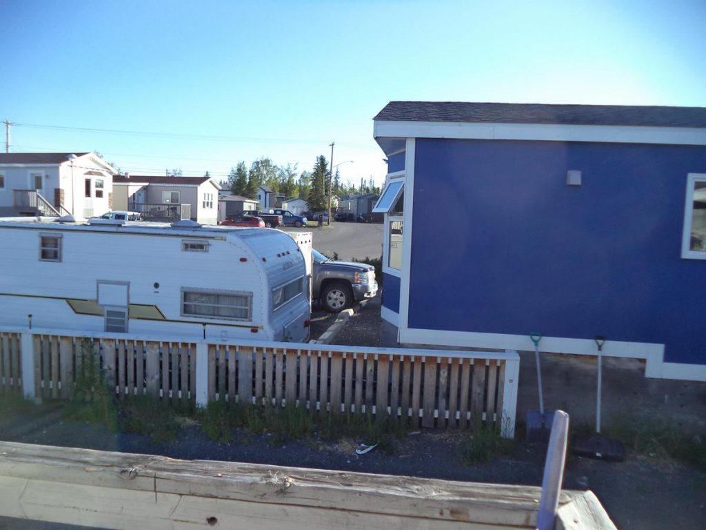 Outside the house where Tony and Tatiana stayed. View of single-storey prefabricated dwellings.