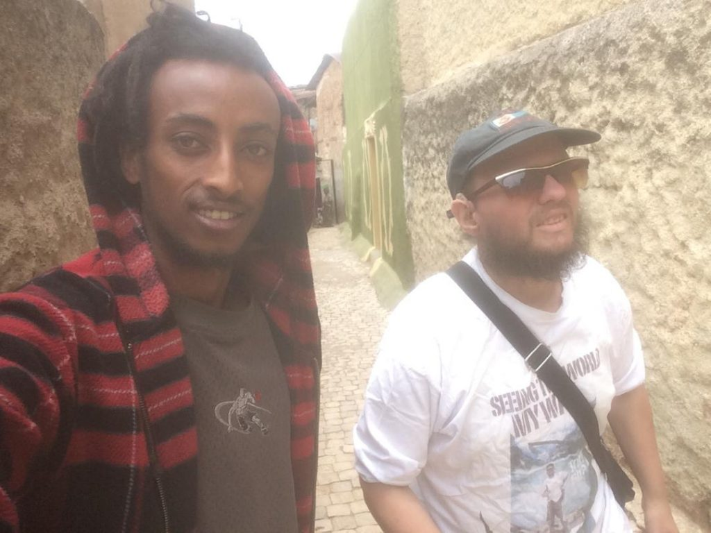 Tony with Mikiyas, a local guy in one of Harar's narrow streets.