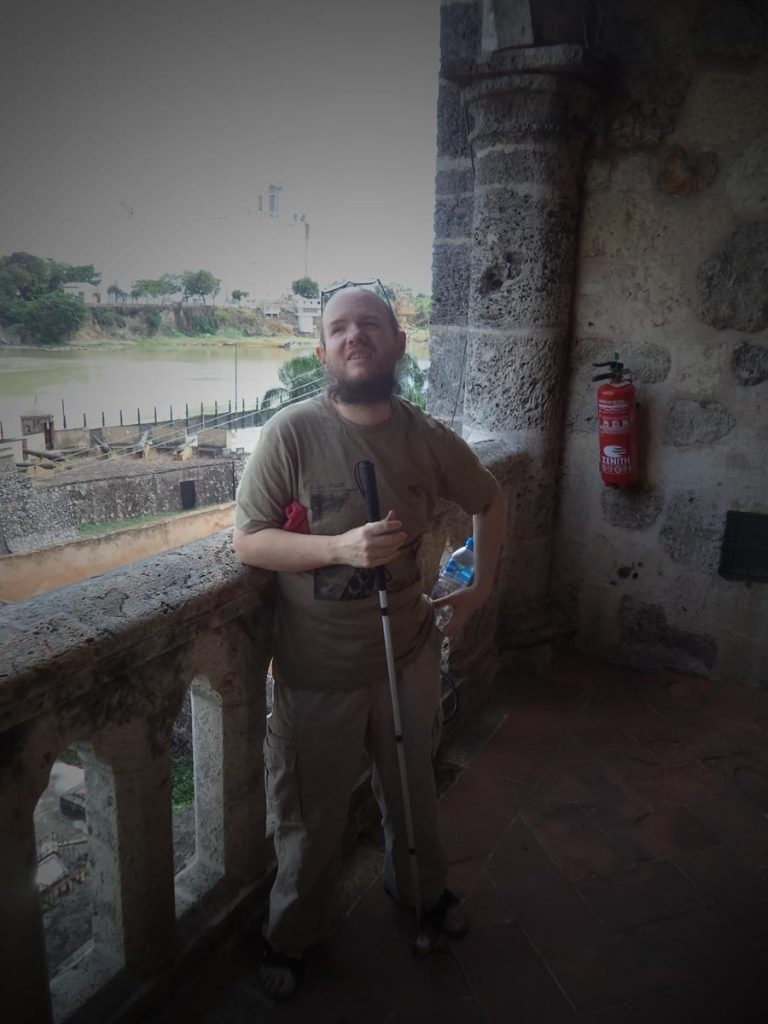 Tony on the veranda of the Alcázar de Colón. The Ozama River can be seen below, just before it enters the Caribbean Sea.