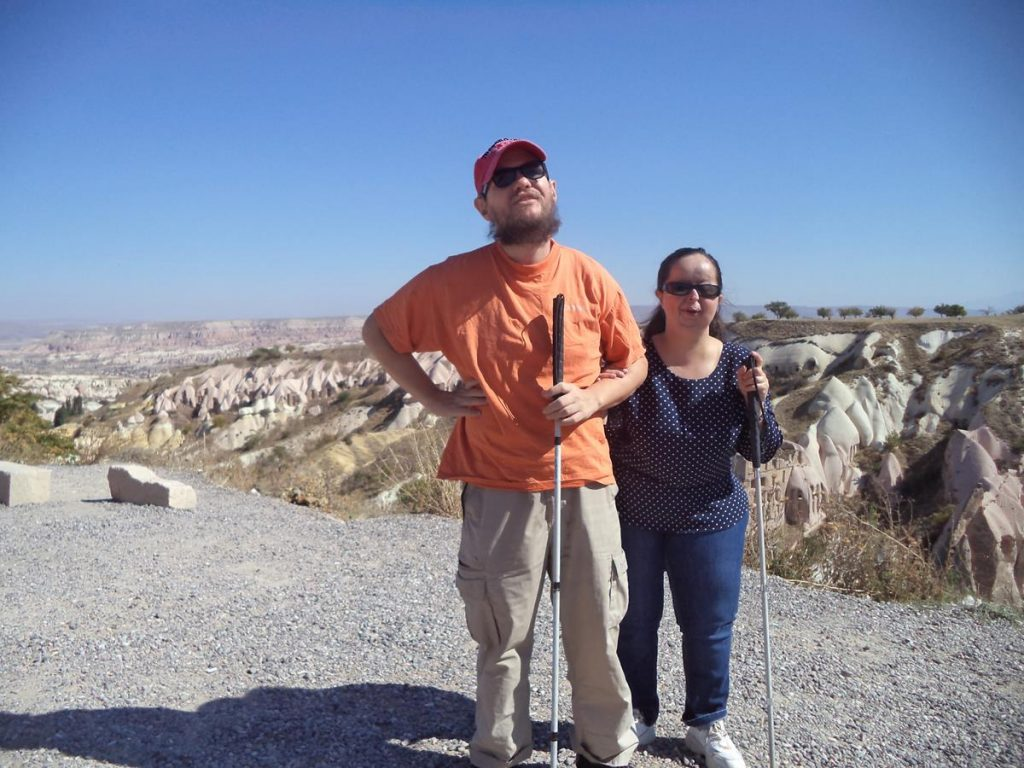 Tatiana and Tony at the Pigeon Valley vista point. Spectacular view along Pigeon Valley and out far beyond across the rocky landscape of Cappadocia.