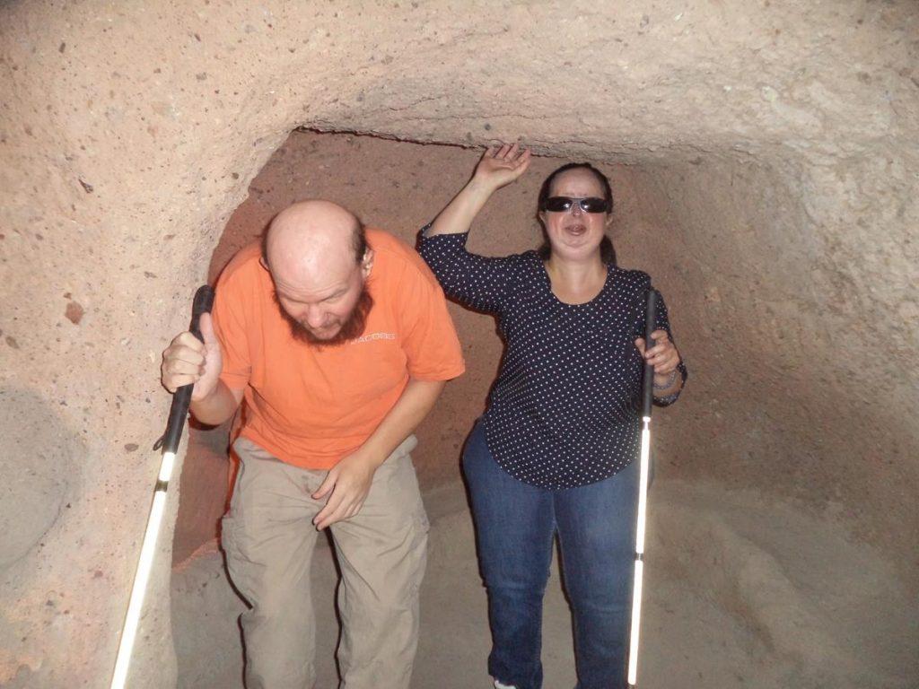 Tony and Tatiana inside a small cave room, part of the underground city of Kaymakli.