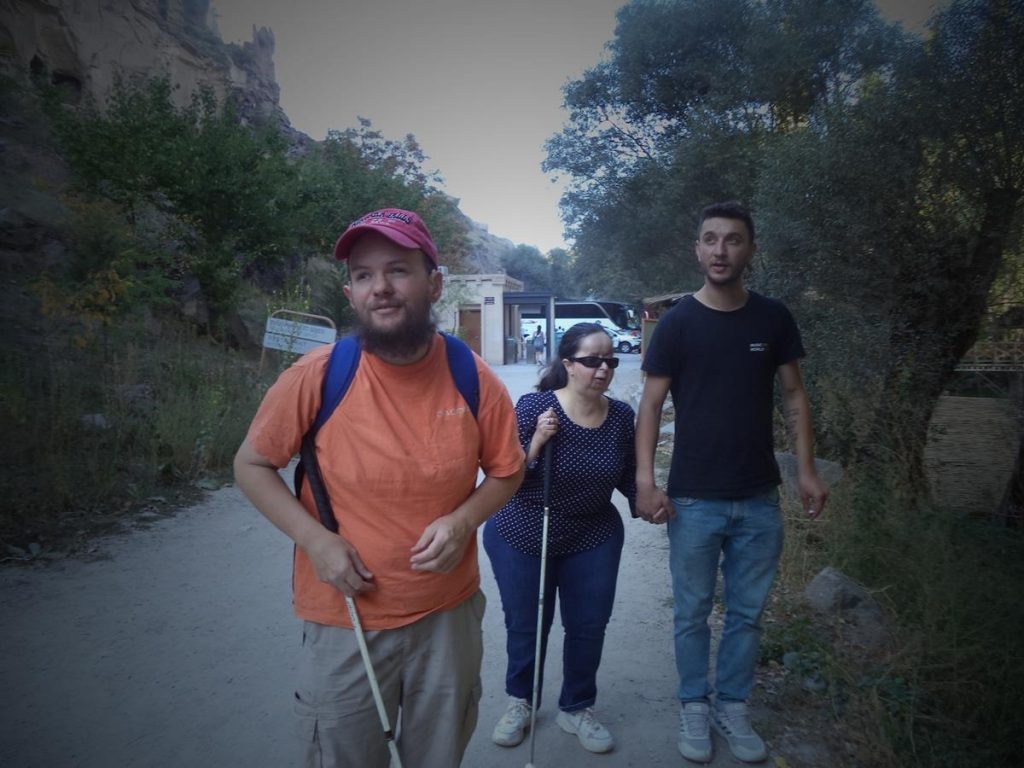 Tony, Tatiana and a Turkish guide walking down a path in Ihlara Valley.