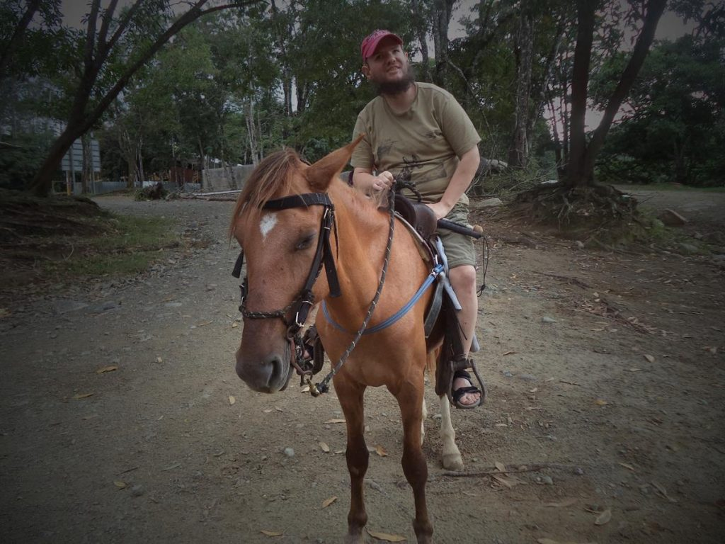 Tony sat on a local horse near the confluence of the Jimenoa and Yaque del Norte rivers, near to downtown Jarabacoa.