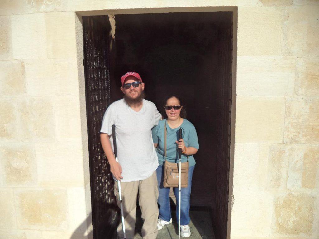 Tony and Tatiana standing just inside the church's doorway.