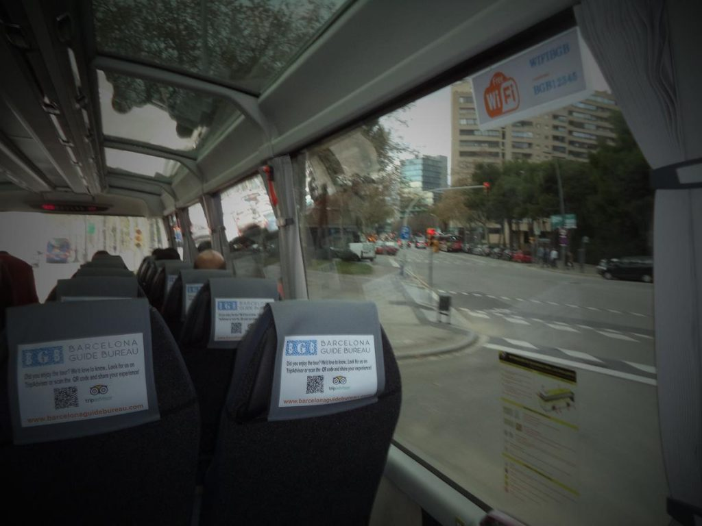 On a coach leaving Barcelona for Montserrat Monastery. A boulevard in central Barcelona visible through the window.