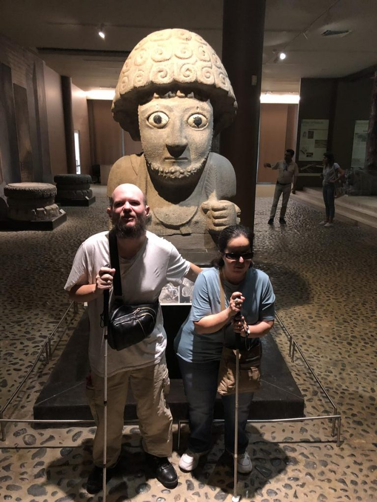 Tatiana and Tony in front of a striking 3000-year-old statue of  Hittite King Suppiluliuma. It was unearthed at Tell Tayinat, an ancient  site in the Hatay region. It is 1.5 metres in height, although the  statue only survives from the waist up, so it was once taller. The  stylised face has very large staring eyes and a beard.