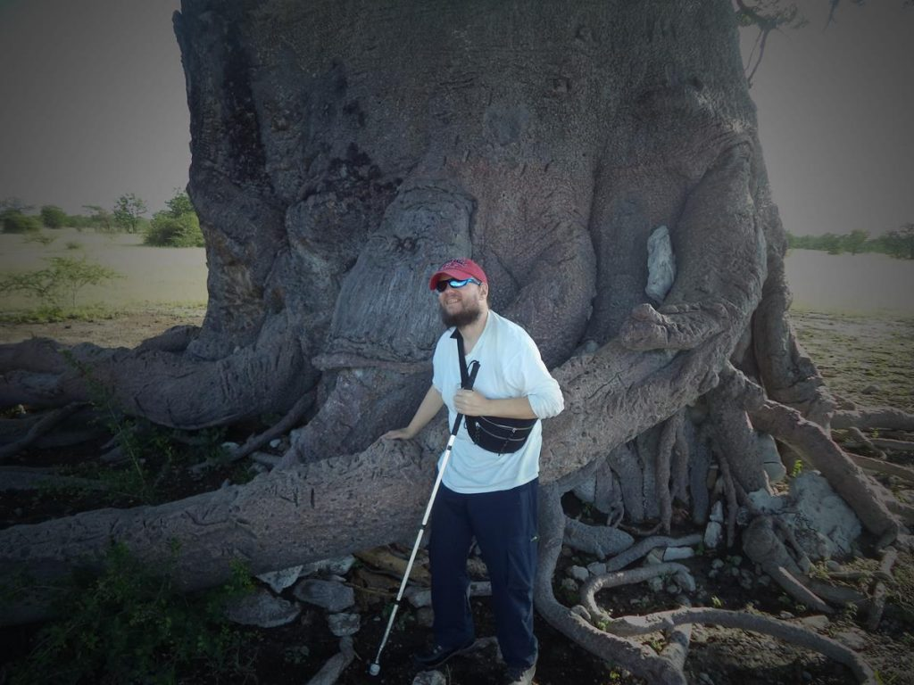 Another shot of Tony in front of a baobab tree.