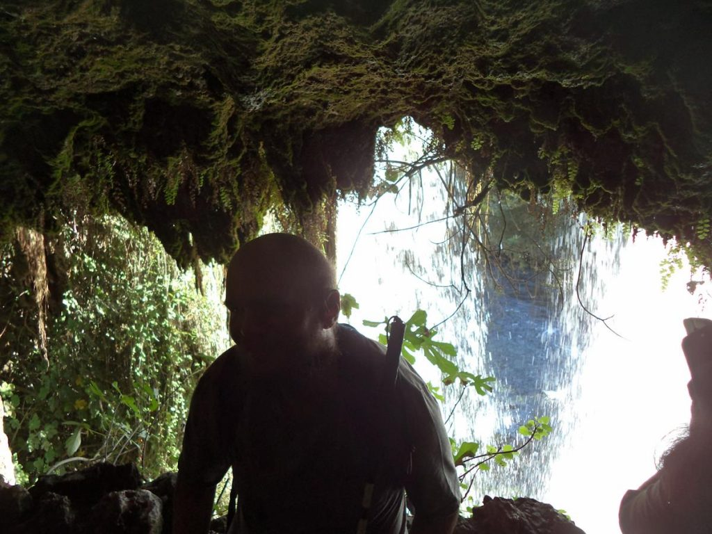 Tony in the mouth of a cave with the Upper Düden Falls behind.