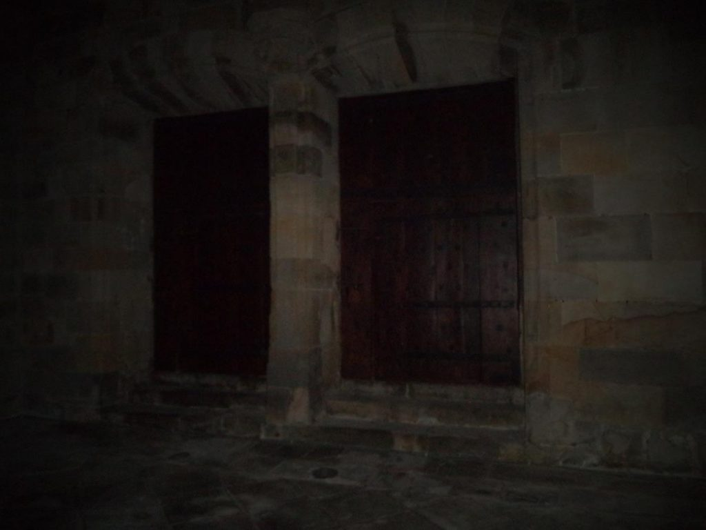A pair of wooden doors in the cathedral walls.