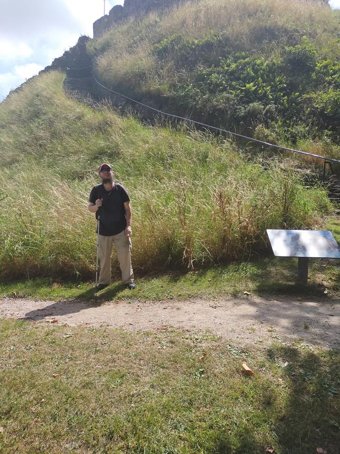 Another view of Tony at the foot of the motte with the keep part visible at the top.