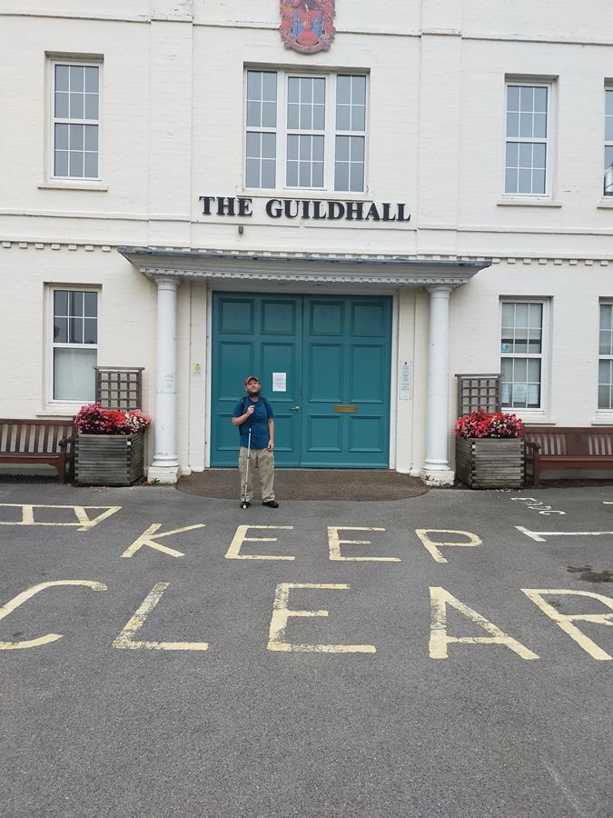 Tony in front of the main doorway to Axminster Guildhall. This cream painted building was built in 1931. It is today an events and entertainment venue and is also home to the town council.