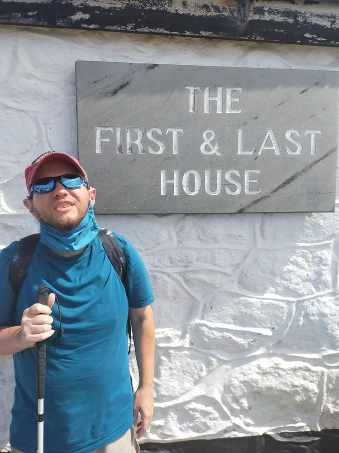 Tony outside the First and Last House, a souvenir shop and café at Land's End, which has existed since the 19th century. This is the most westerly house in mainland England.
