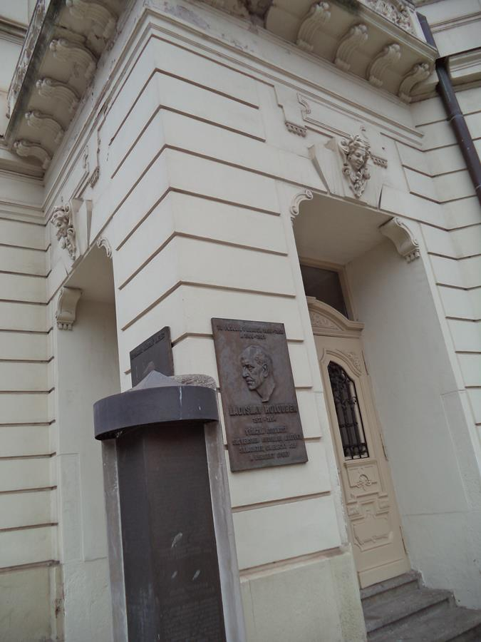 A corner pillar at the entrance to the Košice State Theatre. Two embossed panels are attached to it. The nearest one is dedicated to Ladislav Holoubek (1913-1994): a Slovak composer and conductor.