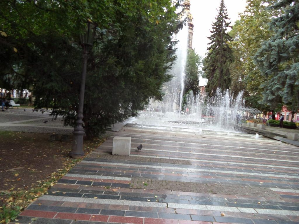 Another park, this one is located between the north side of the Košice State Theatre and St Elisabeth Cathedral. In front is the Singing Fountain (Spievajúca fontána). Jets of water can be seen rising from this large rectangular fountain. At certain times the jets of water are lit up and spray in choreography with music.