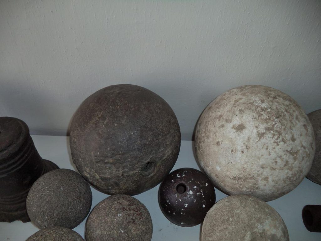 A display of old stone canon balls of various sizes, located inside Mikluš Prison. This former prison is now a museum. The prison was built in the early 17th century on the site of two medieval houses. It operated as a prison until the early 20th century.