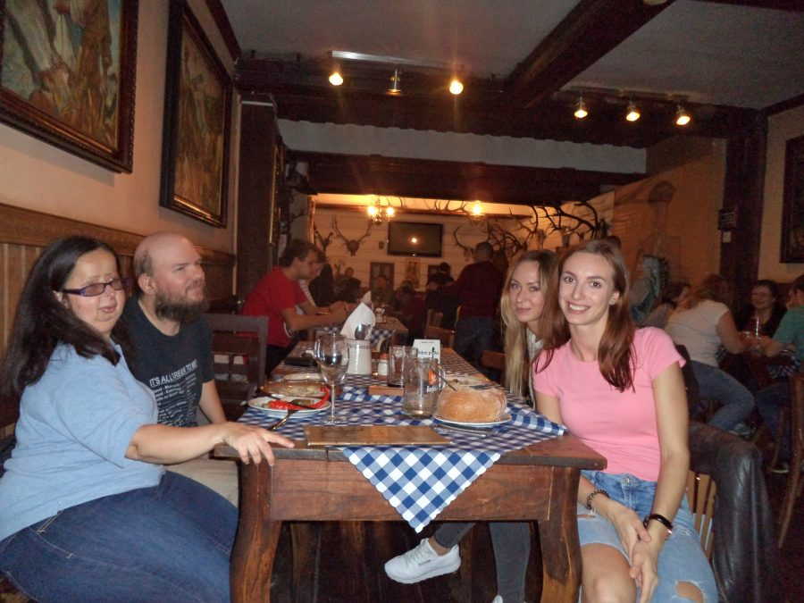 Sitting at a table in the Slovak Pub. Tony with Tatiana, Viktoria and Livia. Viktoria and Livia are two medical students from Eastern Slovakia, living in Bratislava, Tony met Viky through couchsurfing. The pub has a wooden interior with the heads of stuffed animals on the walls, plus various paintings and decorations.