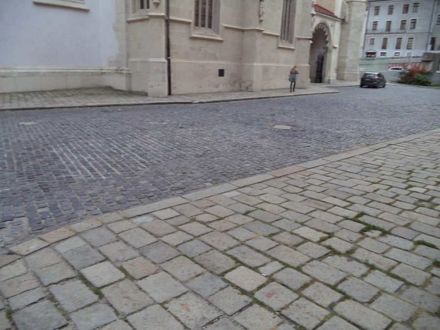 The front of St. Martin's Cathedral (only the lower part is visible). This large Roman-Catholic Cathedral is located in the Old Town close to the River Danube and the New Bridge. It is fortified gothic in style and was consecrated in 1452. It is the largest and one of the oldest churches in Bratislava. It is known especially for being the coronation church of the Kingdom of Hungary between 1563 and 1830. Its 85 metre (279 foot) tall spire dominates the city skyline.