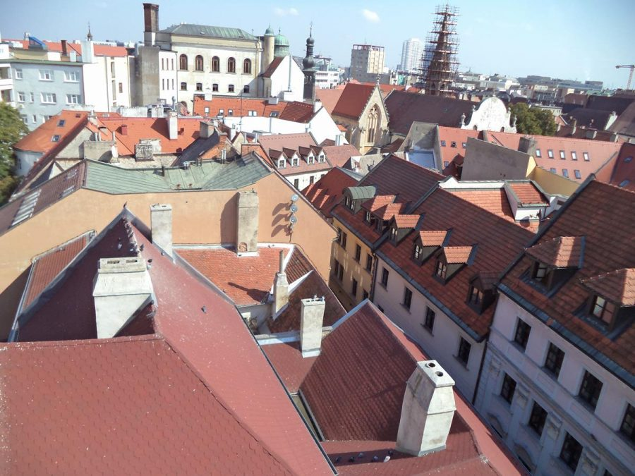 View east from the balcony over the Old Town. Towards the right, the Franciscan Church can be seen with its spire covered with scaffolding. The Franciscan Church was consecrated in 1297, making it the oldest existing religious building in the Old Town.
