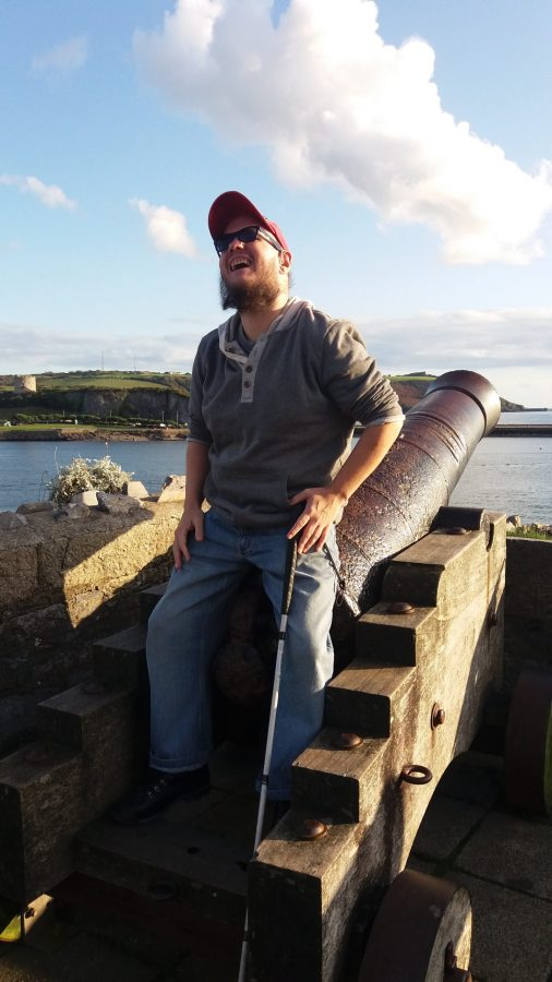 Another view of Tony sat on one of the old cannons.