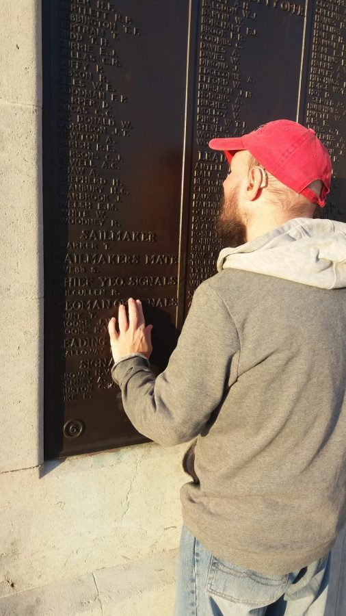 Tony feeling names inscribed on the Naval Memorial.