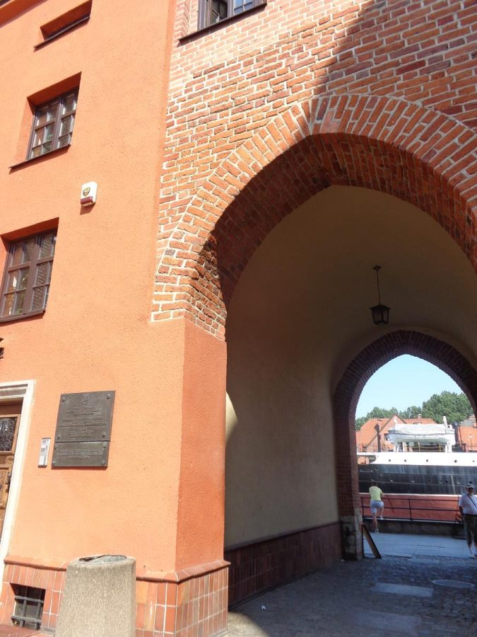 View through St John's Gate with the Motława river and part of the SS Soldek visible at the far end.