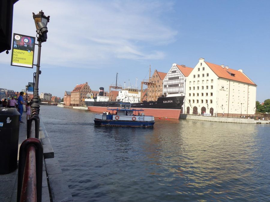 View back north along the Motława river with the historic granaries and SS Soldek on Ołowianka island in clear view.