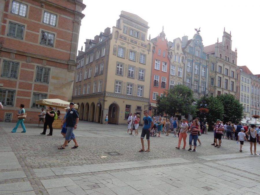 Looking from the south-east end of Long Market (Długi Targ). This long narrow square was formerly the main city market. It is lined with historic buildings, many dating from between the 16th and 18th centuries, once the homes of the most wealthy city residents. Most buildings here today were destroyed during World War Two and have been rebuilt in their original styles.