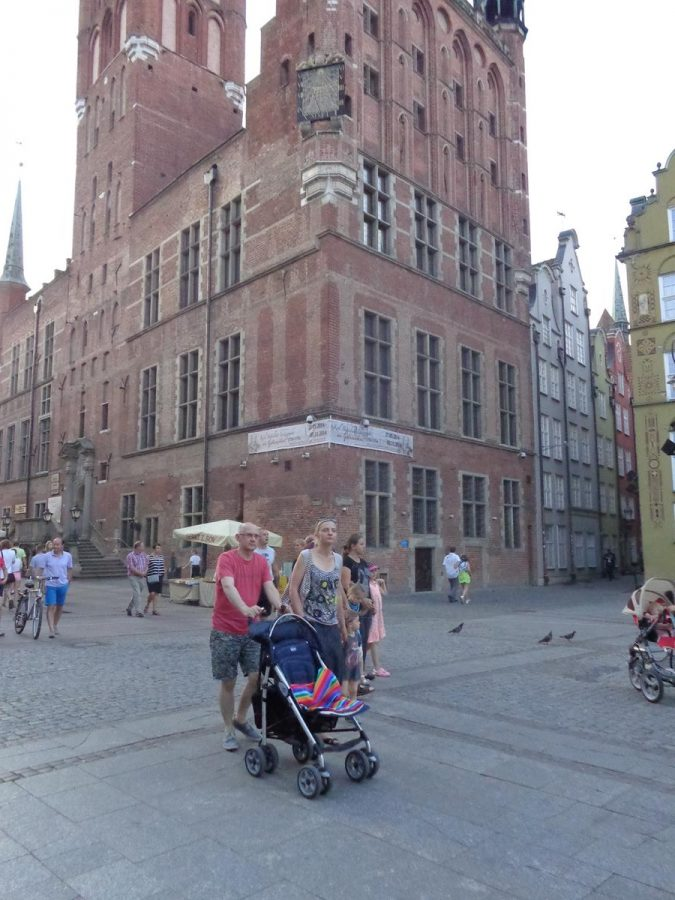 A closer view of Gdansk Town Hall. Details in view include a Gothic spire in the far visible corner of this very large brick building and high up in the nearest corner a sundial.