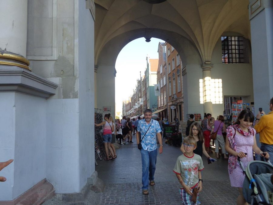 Standing inside Golden Gate (Złota Brama), with a vaulted ceiling above, and looking up Long Street (Długa).
