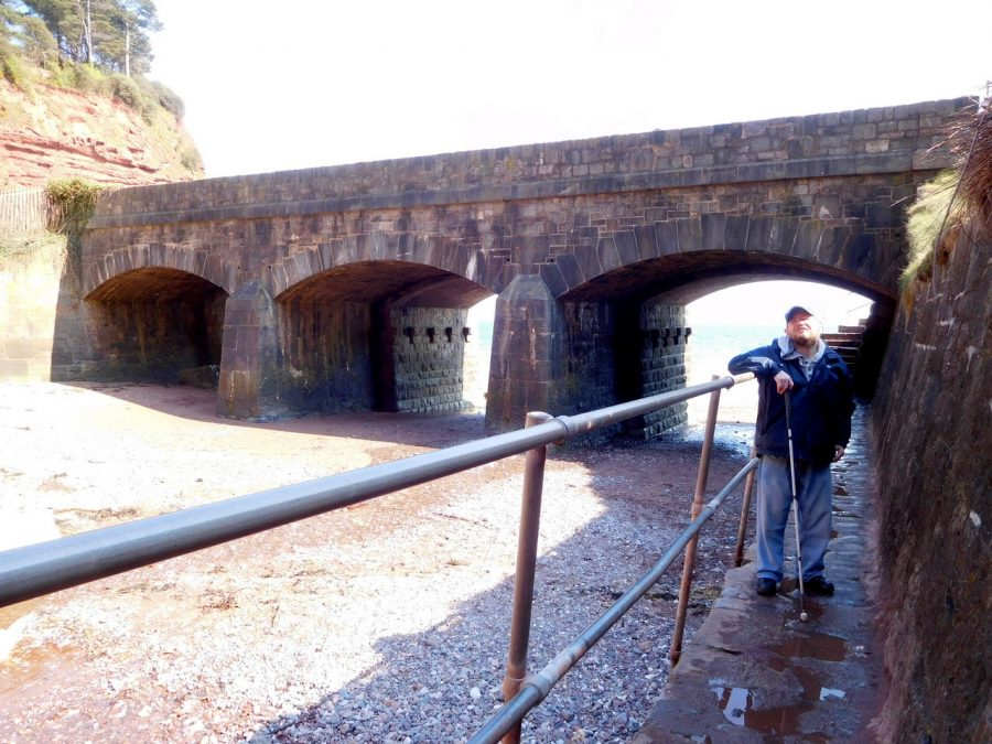 The 3-arched railway bridge, leading out of Teignmouth towards Dawlish, with Tony on the right.